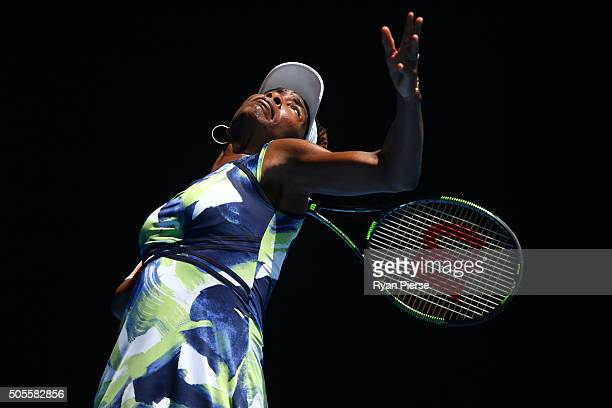Venus Williams of the United States serves in her first round match against Johanna Konta of Great Britain during day two of the 2016 Australian Open...