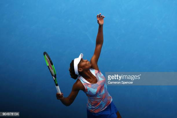 Venus Williams of the United States serves in her first round match against Belinda Bencic of Switzerland on day one of the 2018 Australian Open at...