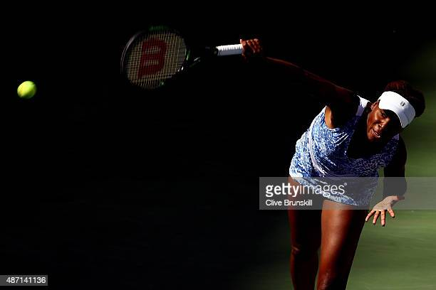 Venus Williams of the United States serves to Anett Kontaveit of Estonia during their Women's Singles Fourth Round match on Day Seven of the 2015 US...