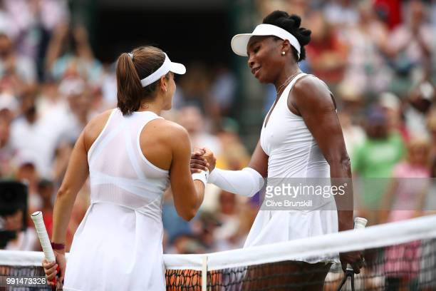 Venus Williams of The United States shakes hands with Alexandra Dulgheru of Romania after their Ladies' Singles second round match on day three of...