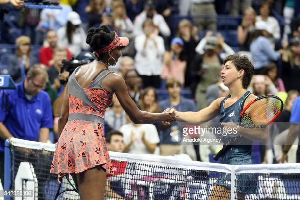 Venus Williams of the United States shakes hands with Carla Suárez Navarro of Spain after defeating her in Women's Singles round four tennis match...