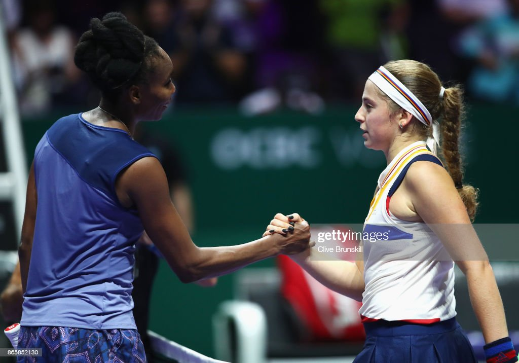 Venus Williams of the United States shakes hands with Jelena Ostapenko of Latvia as she celebrates victory after their singles match during day 3 of the BNP Paribas WTA Finals Singapore presented by SC Global at Singapore Sports Hub on October 24, 2017 in Singapore.
