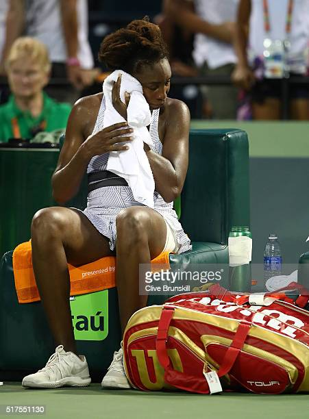 Venus Williams of the United States shows her dejection after her three set defeat against Elena Vesnina of Russia in their second round match during...