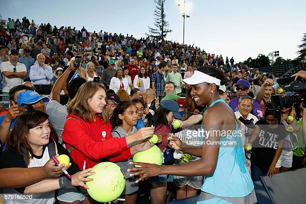 Venus Williams of the United States signs autographs for fans after a win against Catherine Bellis of the United States during day five of the Bank...