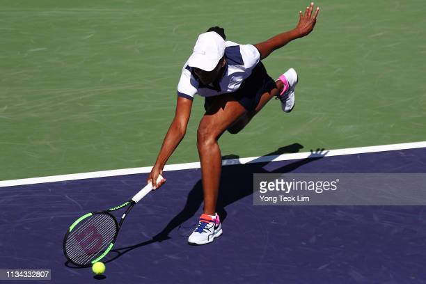 Venus Williams of the United States stretches for a forehand against Andrea Petkovic of Germany during their women's singles first round match...