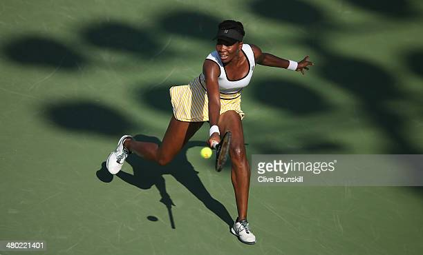 Venus Williams of the United States stretches to play a backhand against Casey Dellacqua of Australia during their third round match during day 7 at...