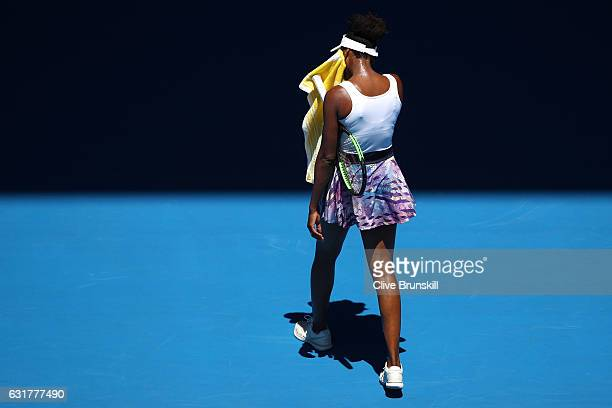 Venus Williams of the United States towels down in her first round match against Katerina Kozlova of the Ukraine on day one of the 2017 Australian...