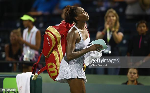 Venus Williams of the United States walks off court after her three set defeat against Elena Vesnina of Russia in their second round match during the...