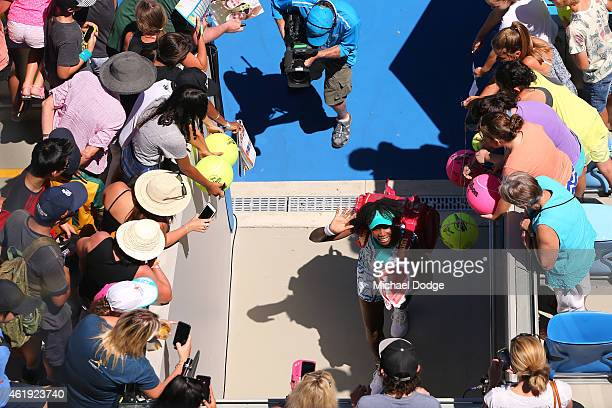 Venus Williams of the United States waves to fans after winning in her second round match against Lauren Davis of the United States during day four...