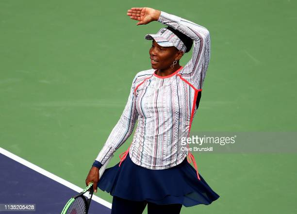 Venus Williams of the United States waves to the crowd after her straight sets victory against Christina McHale of the United States during their...