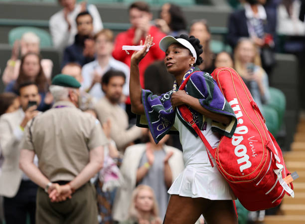Venus Williams of The United States waves to the crowd as she walks off the court after loosing her Ladies' Singles Second Round match against Ons...