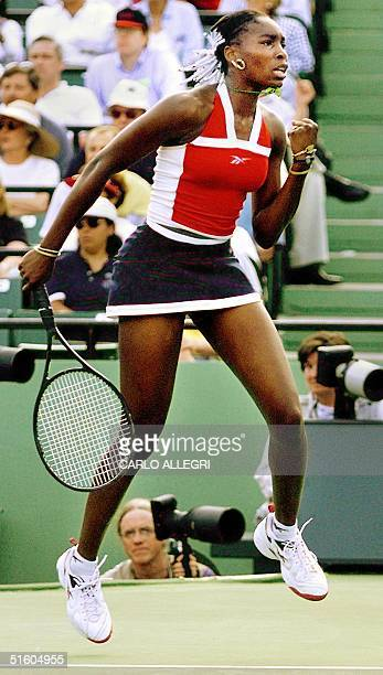Venus Williams of the US celebrates her victory over Jana Novotna of the Czech Republic in their quarter-final match at the Lipton Tennis...