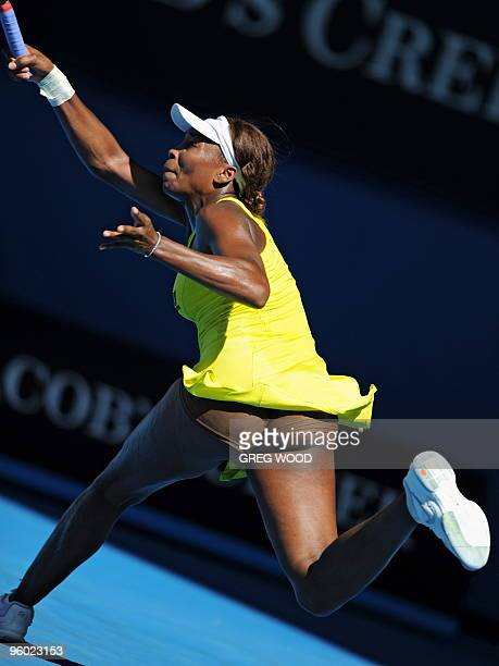 Venus Williams of the US hits a return against Casey Dellacqua of Australia in their women's singles third round match on day six of the Australian...