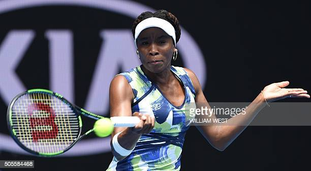 Venus Williams of the US plays a forehand return during her women's singles match against Britain's Johanna Konta on day two of the 2016 Australian...