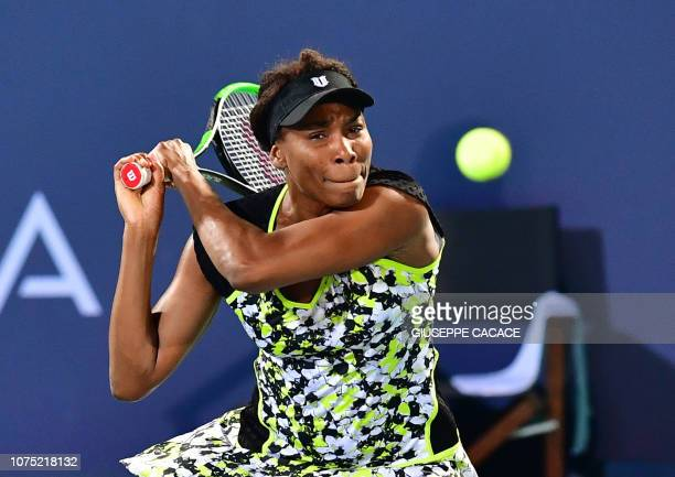 TOPSHOT Venus Williams of the US plays the ball to Serena Williams of the US during the 2018 Mubadala World Tennis Championship match in Abu Dhabi on...