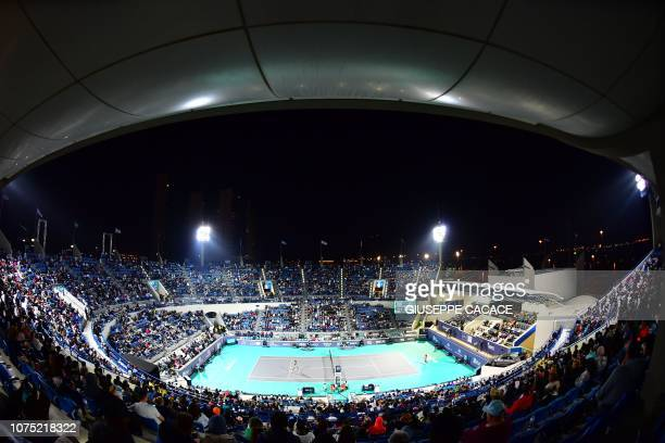 Venus Williams of the US plays the ball to Serena Williams of the US, during the 2018 Mubadala World Tennis Championship match in Abu Dhabi, on...