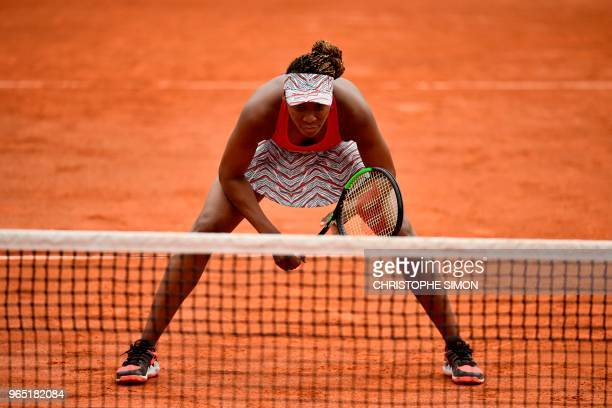 TOPSHOT Venus Williams of the US prepares to receive serve as she and her partner sister Serena Williams play during their women's doubles second...