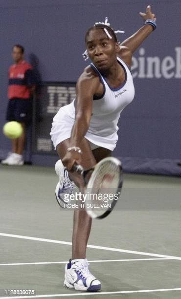 Venus Williams of the US reaches for a backhand against AnneGaelle Sidot of France 01 September at the 1999 US Open in Flushing Meadows Nw York AFP...