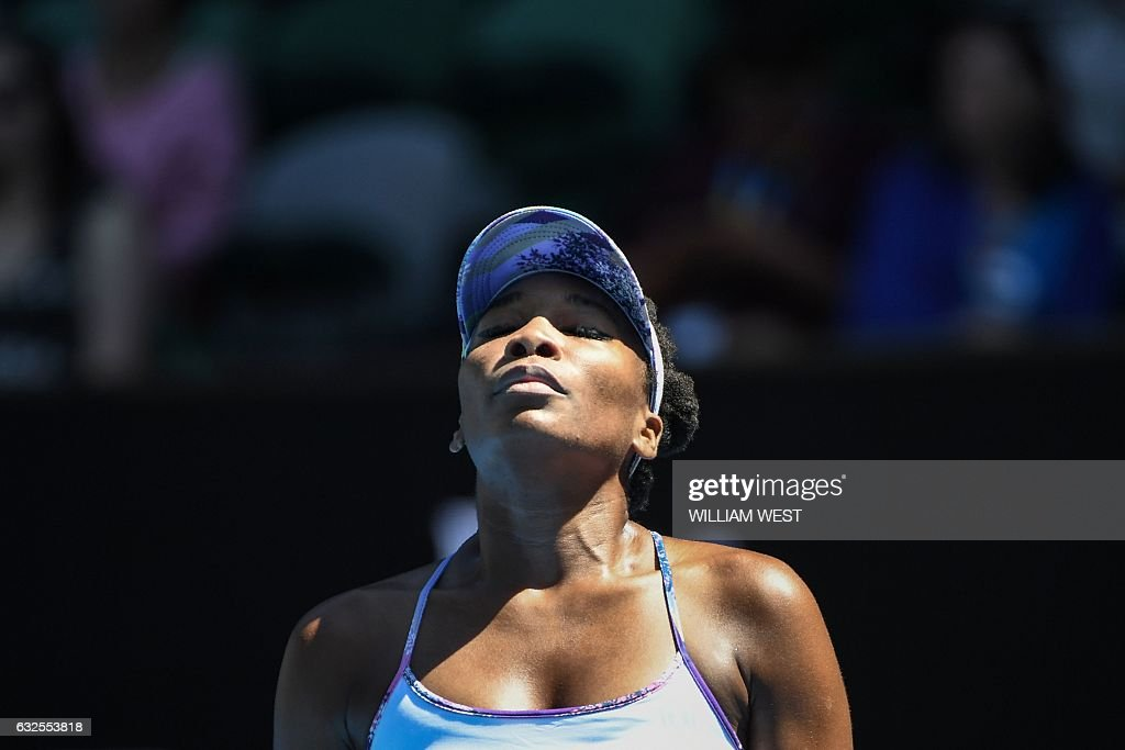 TOPSHOT - Venus Williams of the US reacts after a point against Russia's Anastasia Pavlyuchenkova during their women's singles quarter-final match on day nine of the Australian Open tennis tournament in Melbourne on January 24, 2017. / AFP / WILLIAM