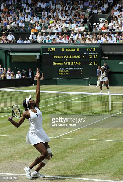 Venus Williams of the US serves against her sister Serena during their Women's Singles Final of the 2009 Wimbledon Tennis Championships at the All...