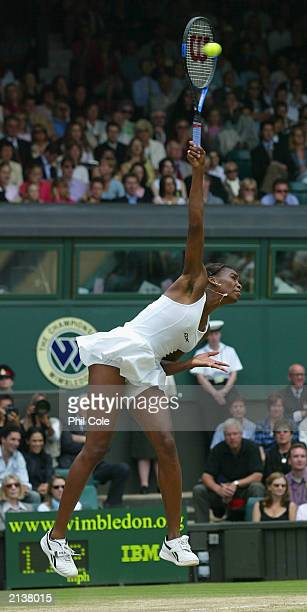 Venus Williams of the U.S. Serves against Serena Williams of the U.S. In the Womens Singles Final during day twelve of the Wimbledon Tennis...
