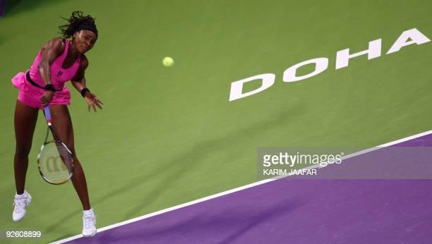 Venus Williams of the US serves to Serbia's Jelena Jankovic during their WTA Championships semi-final tennis match at the Khalifa International...