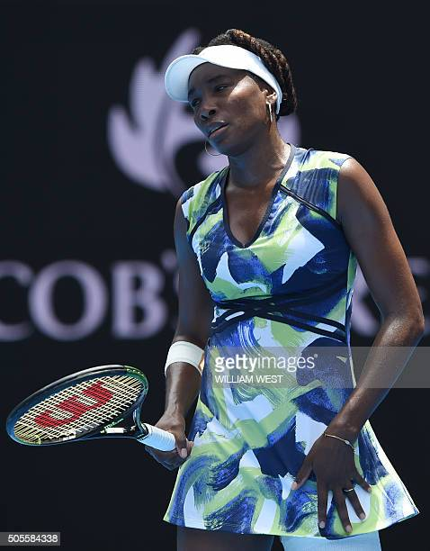 Venus Williams of the US walks on court during her women's singles match against Britain's Johanna Konta on day two of the 2016 Australian Open...