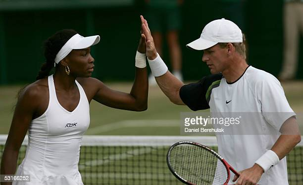 Venus Williams of the USA congratulates her doubles partner Mark Knowles of the Bahamas in their Mixed Doubles match against Olivier Rochus and Kim...