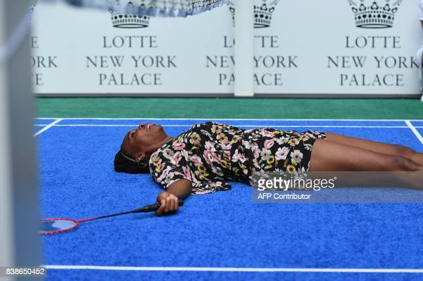 Venus Williams of the USA falls down during her match to world number one tennis player Rafael Nadal of Spain as they participate in the Lotte New...