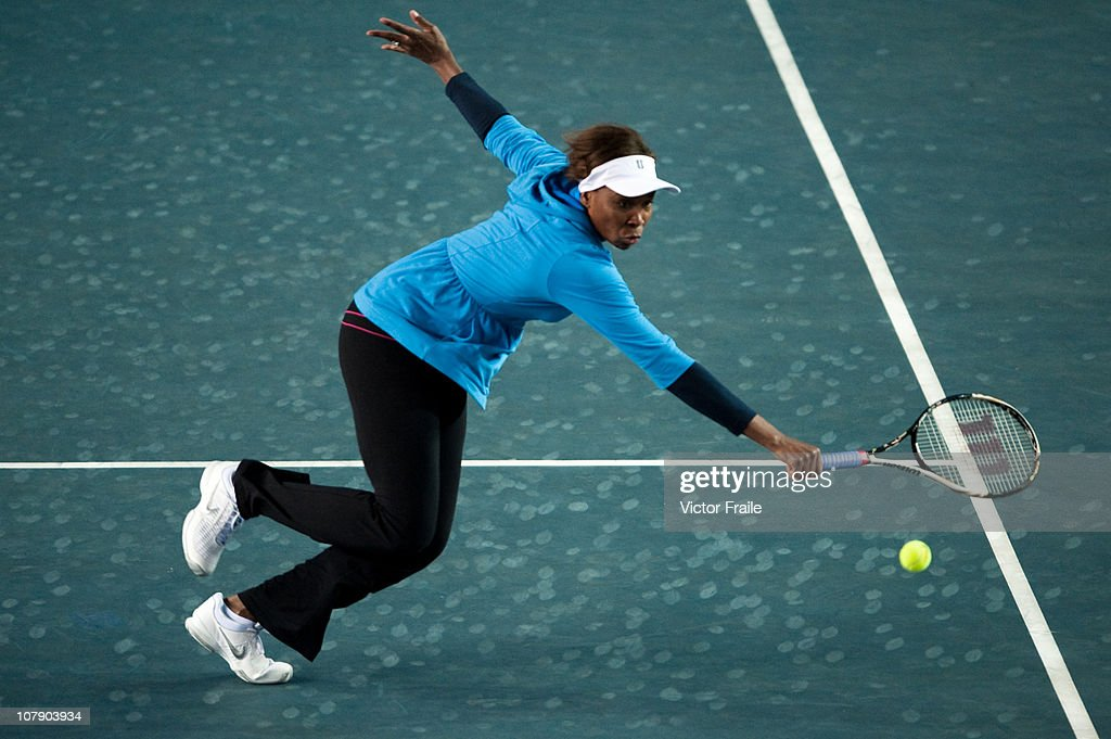 Venus Williams of the USA goes for the ball during her doubles match with John McEnroe of the USA against Vera Zvonareva and Yevgeny Kafelnikov of Russia on day two of the Hong Kong Tennis Classic at the Victoria stadium on January 6, 2011 in Hong Kong, China.