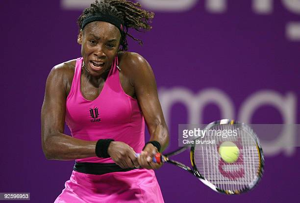 Venus Williams of the USA in action against Serena Williams of the USA in the Women's final during the Sony Ericsson Championships at the Khalifa...