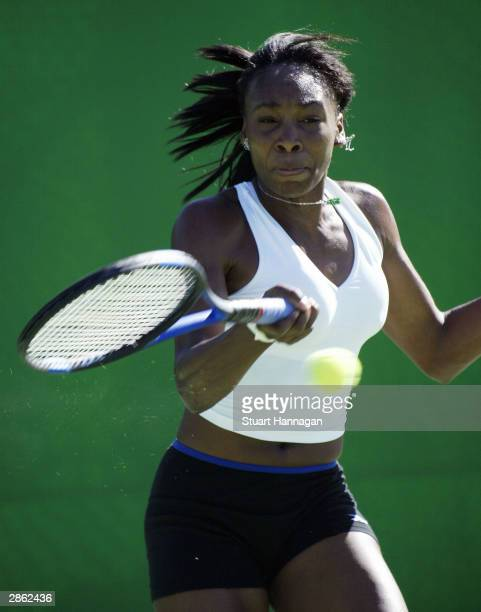Venus Williams of the USA in action during a practice on an outside court January 12, 2004 at Melbourne Park in Melbourne, Australia.