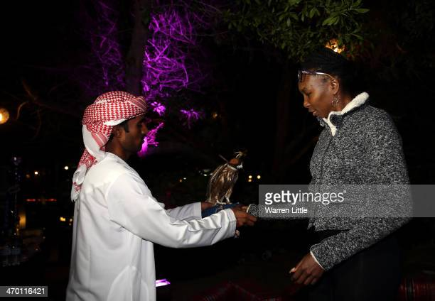 Venus Williams of the USA is shown a falcon during the players party on day two of the WTA Dubai Duty Free Tennis Championship at the Dubai Tennis...