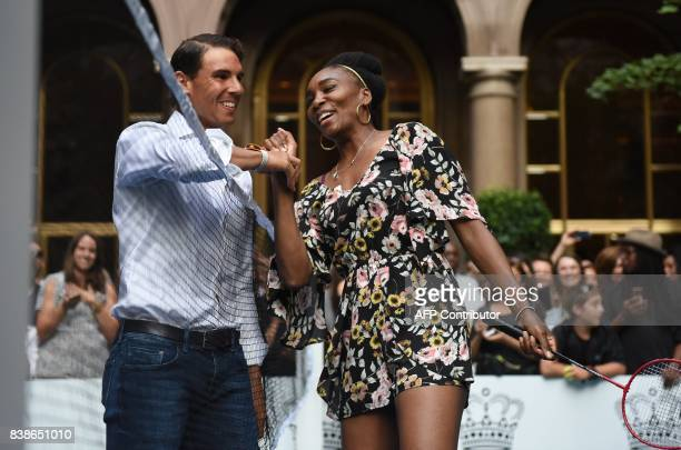 Venus Williams of the USA jokes with world number one tennis player Rafael Nadal of Spain as they participate in the Lotte New York Palace...