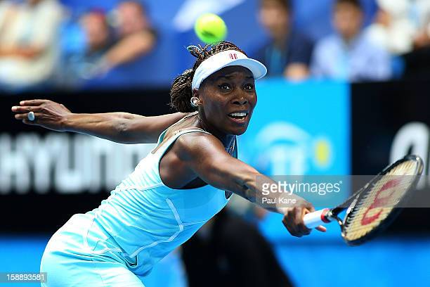 Venus Williams of the USA plays a backhand in her match against Anabel Medina Garrigues of Spain during day six of the Hopman Cup at Perth Arena on...