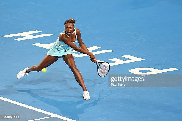 Venus Williams of the USA plays a backhand to Mathilde Johansson of France in her singles match during day four of the Hopman Cup at Perth Arena on...