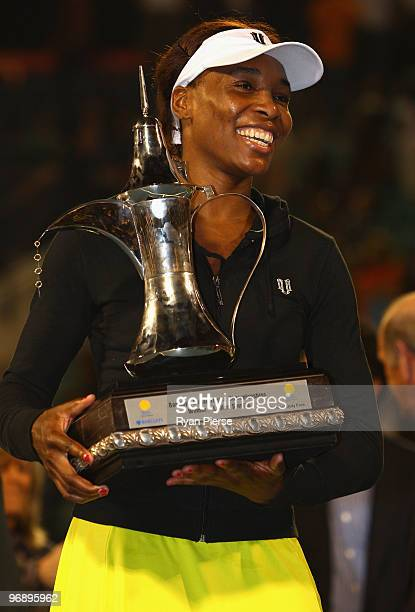 Venus Williams of the USA poses with her winners trophy after her final match against Victoria Azarenka of Belarus during day seven of the WTA...