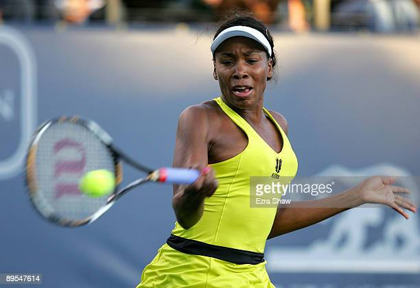 Venus Williams of the USA returns a shot to Maria Sharapova of the USA in their quarterfinal match on Day 5 of the Bank of the West Classic July 31,...