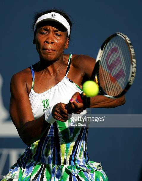 Venus Williams of the USA returns a shot to Stephanie Dubois of Canada during their match on Day 2 of the Bank of the West Classic at Stanford...