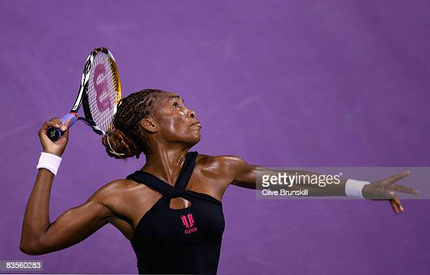 Venus Williams of the USA serves against Dinara Safina of Russia in their first round robin match during the Sony Ericsson Championships at the...