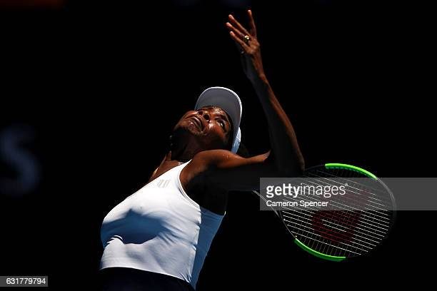 Venus Williams of the USA serves during her first round match against Katerina Kozlova of the Ukraine on day one of the 2017 Australian Open at...