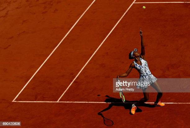 Venus Williams of The USA serves during the second round match against Kurumi Nara of Japan on day four of the 2017 French Open at Roland Garros on...