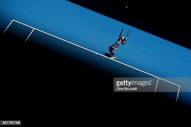 Venus Williams of the USA serves in her first round match against Kateryna Kozlova of the Ukraine on day one of the 2017 Australian Open at Melbourne...