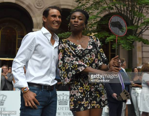 Venus Williams of the USA stands with world number one tennis player Rafael Nadal of Spain following their match in the Lotte New York Palace...