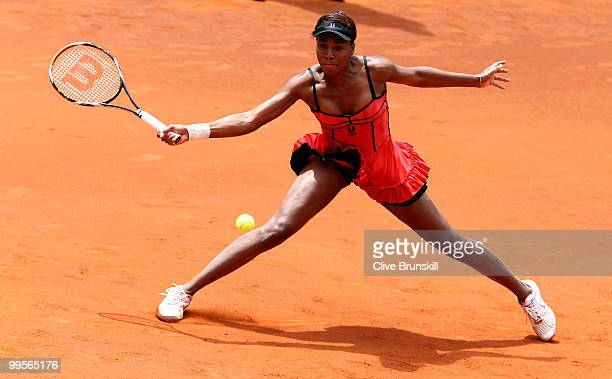 Venus Williams of the USA stretches to play a forehand against Shahar Peer of Israel in their semi final match during the Mutua Madrilena Madrid Open...