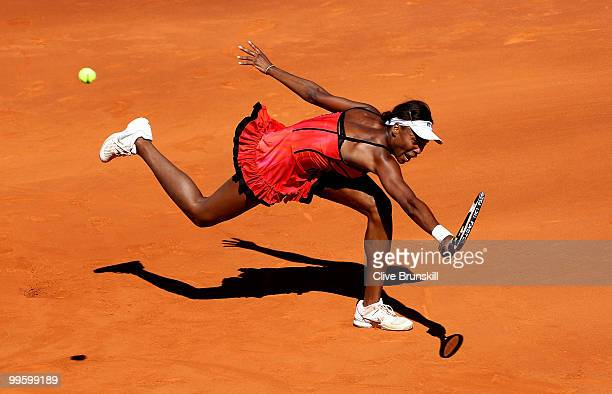 Venus Williams of the USA stretches to reach a backhand against Aravane Rezai of France in the womens final match during the Mutua Madrilena Madrid...