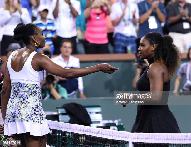Venus Williams of United States hug Serena Williams after her win over her sister during Day 8 of BNP Paribas Open on March 12, 2018 in Indian Wells,...