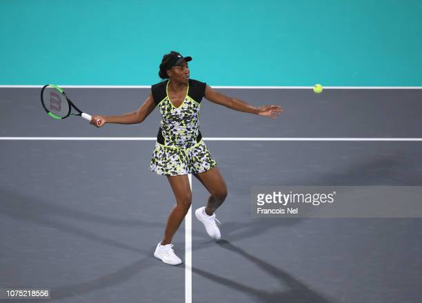 Venus Williams of United States in action against Serena Williams of United States during her Women's singles match on day one of the Mubadala World...