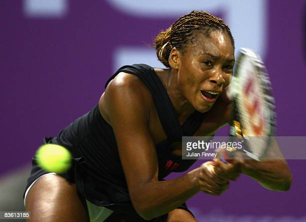 Venus Williams of United States plays a backhand in her match against Jelena Jankovic of Serbia during the Sony Ericsson Championships at the Khalifa...