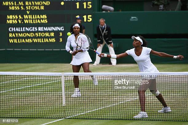 Venus Williams of United States plays with Serena Williams of United States during the women's doubles Final match against Lisa Raymond of United...